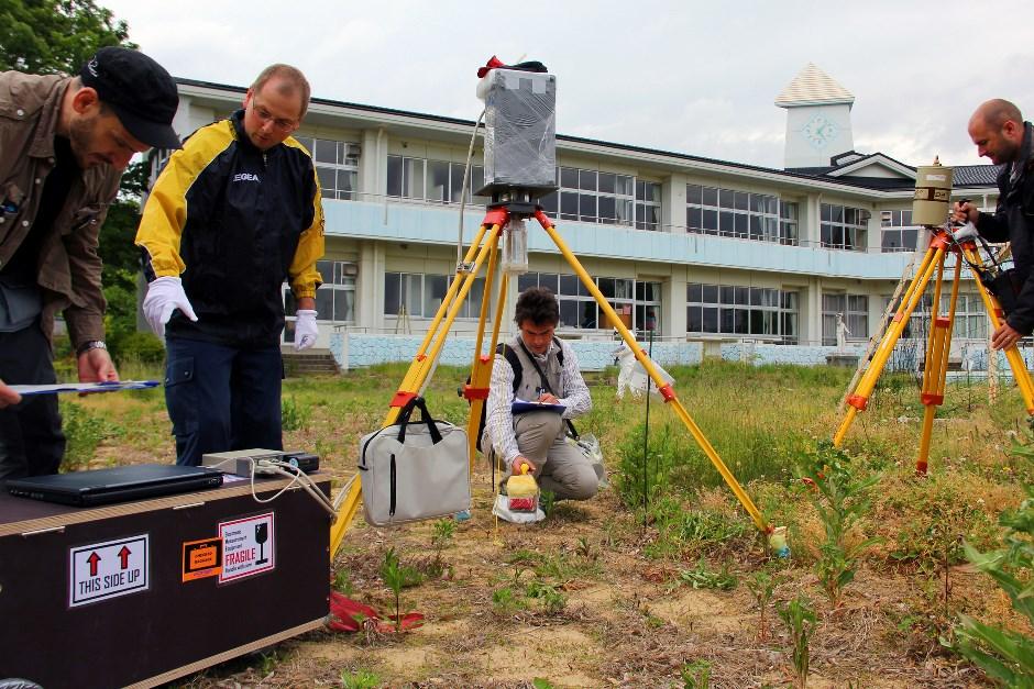 Scientists taking measurements
